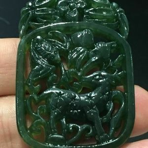 Exquisite Hand-carved Hetian Jade Deer Pendant.